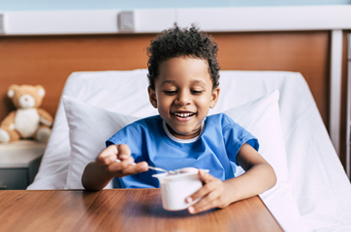 Pediatric patient eating a meal