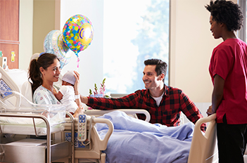 New parents in hospital delivery room
