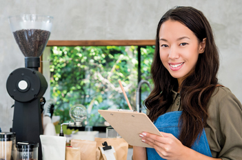 Business owner smiling in coffee shop