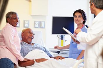 Hospital staff in patient's room