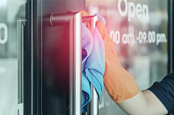Door handle being cleaned