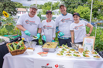 Group of Aramark employees serving food