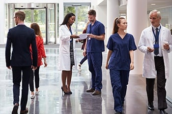 Hospital staff walking in hallway