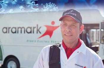 Aramark employee in front of truck